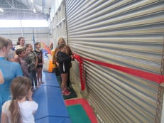 Maia Whitney cuts the ribbon